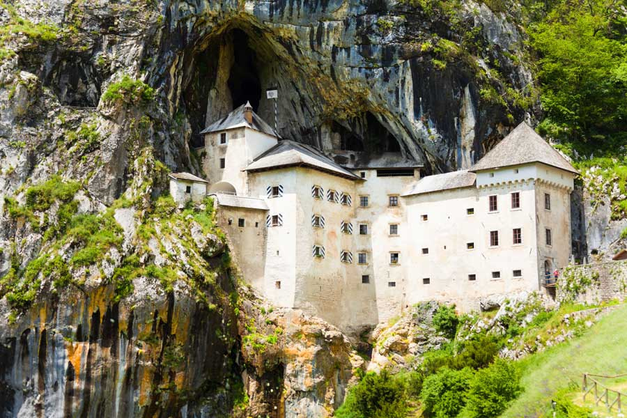 This image has an empty alt attribute; its file name is Predjama-Castle-Postojna-Slovenia-Adventures-Croatia.jpg